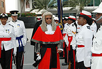 Chief Justice the Hon. Anthony Smellie, QC, inspects the police guard of honour.