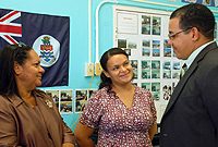 Student Teacher Dionne McLaughlin (centre) updates Hon. Deputy Premier, Juliana O'Connor-Connolly, JP (left) and Education Minister, Hon. Rolston Anglin, on her work at Creek and Spott Bay Primary School.