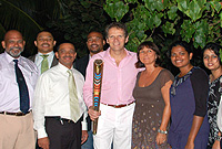 His Excellency the Governor, Mr. Duncan Taylor, CBE (centre, holding baton) and Mrs. Beatrice Taylor at Government House on Thursday evening, (1 April) hosting Ministers, MLAs, officials, visitors and athletes who took part in Cayman's leg of the Queen's Baton Relay.