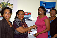 Members of the Rotaract Blue Club present a cheque for $5500 to Department of Children and Family Services (DCFS) personnel for the West Bay Golden age Home. (Left -Right) DCFS Disaster Coordinator Lynda Mitchell; Adult Special Needs Programme Coordinator Dawn Rankine; Rotaract VP Yvette Cacho and President Tricia Cacho.