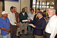 Nearly $281,000 was paid to sub-contractors who assisted Matrix International Ltd. with scrap-metal removal in 2007. Accompanied by Community Affairs Minister, the Hon. Michael Adam, MBE, (right) and Councillor for Housing Ellio Solomon (3rd from right), the Hon. Premier, W. McKeeva Bush, OBE, JP, (2nd from right) handed out the cheques.