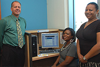 (From left) Education Ministry Information and Communication Technology Manager Steven Durksen, with Library Services Acting Deputy Director Juliet Lawson and Micro Matrix Principal Sandra Catron