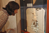 Mrs. Marie-Beatrice Taylor takes a closer look at the turtle display.