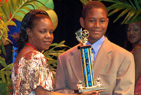 Bonaventure Boys Home resident Antonio Kelly (right) collects the CAYS Foundation Outstanding Academic Achievement Award from Frances Bodden Girls Home Residential Care Worker Annialee Knight-Taylor.