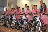 (From left) Akeem Hyde, Kayla Mitchell, Kareem Murray, Deandra Kelly, Steven Rivers, Alyssa Connor, Ashante Jackson, and Casey Ramos each received Huffy bikes for outstanding athletic achievement. With them are some of the sponsors (back row from left) West Bay MLAs Cline Glidden Jr. and Capt. Eugene Ebanks, JP; John A. Cumber alumni Meloney Jackson; and 'School Father' Floyd Bush.