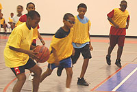 Campers hone their skills at the Department of Sports annual basketball summer camp.