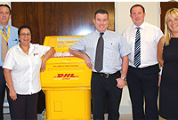 (From L) DHL's Area Sales Manager Rob Brown, Customer Service Agent Esther Rackley and Sales Manager Mark Woollard; Governor's Staff Officer Andy Holbrook and CSC's Account Executive Alexandra Stanley at the first biometric clinic conducted by the UK Border Agency, facilitated by the Governor's Office at Smith Road Centre on Tuesday, 27 July.