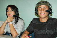 Youth Flex host Kimberly Carlos and co-host Tremayne Ebanks at the control desk.