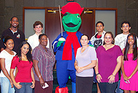 Sir Turtle, the Cayman Airways mascot, with some of this year's Youth Parliament participants, Cayman Brac High School Deputy Principal Hyacinth Downer (front row, third left) and LA Clerk Zena Merren-Chin (front row, third right) at the LA on Saturday, 5 March. The national carrier has provided free travel for the participants from Cayman Brac.