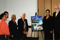 A poster marking Cayman's celebration of the 100th Anniversary of International Women's Day was unveiled Tuesday (8 March) at the Westin Casuarina. Pictured (L-R): Ministry of Community Affairs, Gender and Housing Chief Officer Dorine Whittaker; HE the Governor's wife Mrs. Marie-Beatrice Taylor; National Hero the Hon. Sybil McLaughlin, MBE, JP; Speaker of the Legislative Assembly the Hon. Mary Lawrence, MBE, JP ; Chief Magistrate Margaret Ramsay-Hale and Minister of Community Affairs  Gender and Housing the Hon. Mike Adam, MBE, JP.
