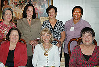 Acting Cayman Islands' UK Representative Mary Chandler-Allen (seated, centre) flanked by former civil servants Jenny Manderson (L) and Jennifer Ritchie.
