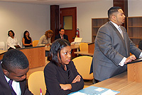 A team presents arguments at the Law Clinic. The students in teams tackled five questions.