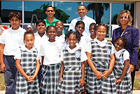 George Town Primary School children with Deputy House Speaker and ERA Councillor, Mr. Cline Glidden Jr. (back row, right), CUC President, Mr. Richard Hew and GTPS Deputy Principal, Mrs. Dorothy Wilson