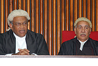 The Hon. Chief Justice, Mr. Justice Anthony Smellie (l) was the first among speakers who showered praise on retiring Court of Appeal Judge, the Hon. Ian Forte (r).