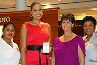 On the eve of her departure to Brazil for the Miss Universe pageant, Miss Cayman Islands Cristin Alexander receives a boxed pendant and necklace as her farewell gift from Kirk Freeport Director Debbie Guyton (second from right), in the presence of Miss Cayman Islands Committee's Ariana Rahamut (left) and Ministry of Finance, Tourism and Development's Deputy Director Pat Ulett.