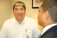(R) Health Minister Mark Scotland, JP speaks with Dr. Robert Lee.