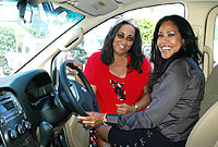 (L) Foster parent Ann Haven and Aall Foundation representative Sophia Harris check out the new vehicle.