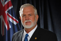 Minister for Community Affairs and Housing, Hon. Michael Adam, MBE, JP.