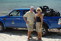 Frank Sound residents Graham and Janet Morse got their hands dirty to clean their beach.