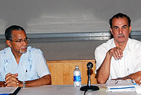 Chairman of the Premier's committee on the UK White Paper 2012, Mr. Lemuel Hurlston, (right) addresses the meeting, with committee member Pastor Alson Ebanks, at the Sir John A Cumber school hall in West Bay on Tuesday (25 October).