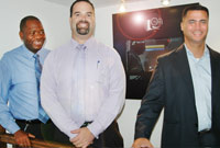 (L-R) Prison Director Dwight Scott, the Portfolio of Internal and External Affairs' Deputy Chief Officer Eric Bush and MLA Ellio Solomon, who chairs the E-Government Committee