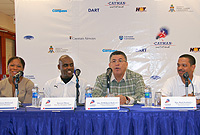 Premier the Hon. W. McKeeva Bush, OBE, JP, addresses a press conference at the Truman Bodden Sports Complex on Saturday (17 March) morning, along with (l-r) star athlete Ms Cydonie Mothersill, CI Athletic Association first vice president  Mr. Harcourt Wason and Sports Minister the Hon. Mark Scotland, JP.