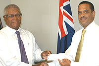 BAF Insurance Cayman's Harvey Stephenson, chairperson of the BAF Board of Directors, hands over a cheque of $5,000 to Minister of Health Mark Scotland in support of Healthy Nation 2012.