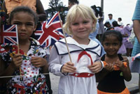 Children await Queen Elizabeth II during her 1994 visit to the Cayman Islands.