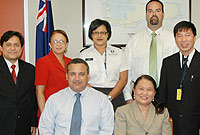 (L-R seated) Deputy Governor the Hon. Franz Manderson and Philippine Labour Attaché Luzviminda Padilla. (L-R standing) Philippine Attaché Sofronio Cortel, Department of Employment Relations Director Jennifer Smith, Chief Immigration Officer Linda Evans, Portfolio of Internal & External Affairs' Chief Officer Eric Bush, Philippine Welfare Officer Saul DeVries, Governor's Staff Officer Tom Hines, and Mr. Art Ursua.
