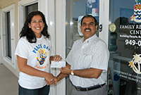 Family Resource Centre Programme Coordinator Miriam Foster receives donation cheque from President of Rotary Central Ravi Kapoor.