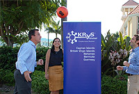KRyS Global Senior Managers Christopher Smith (left) and Matthew Clingerman show-off a few football tricks as FRC's Miriam Foster looks on.